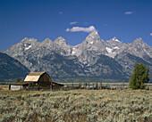 Historic Mormon Barn and Teton Mountain Range, Grand Teton National Park. Teton County, Wyoming. USA.