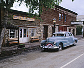 Vintage car on main street National Historic Landmark, Virginia City (town former capital of Montana territory). Madison County, Montana. USA