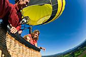 Family in hot-air balloon, Upper Bavaria, Bavaria, Germany