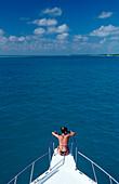 Tourist sitting on Bow, Maldives, Indian Ocean, Medhufushi, Meemu Atoll