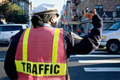 Police officer controlled the traffic, Chinatown, New York, USA, America