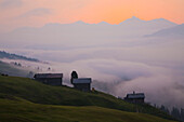 Morning mist and alpine lodges in the morning, Wergenstein, Canton of Grisons, Switzerland