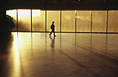 Adult, Adults, Alone, America, Back-light, Backlight, Building, Buildings, Color, Colour, Contemporary, D C , Daytime, District of Columbia, Full-body, Full-length, Horizontal, Human, Indoor, Indoors, Inside, Interior, Mid-Atlantic USA, Museum, Museums,