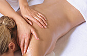 Back, Backs, Beauty, Body, Body care, Color, Colour, Contemporary, Female, Fitness, Hand, Hands, Health, Healthy, Horizontal, Human, Indoor, Indoors, Inside, Interior, Lying down, Massage, Massages, Massaging, People, Person, Persons, Relax, Relaxation,