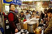 Food vendor, Dongdaemon market. Seoul, South Korea.