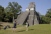 Tourists taking photos of Temple II. Mayan ruins of Tikal. Peten region, Guatemala