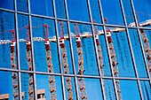 Reflection of construction cranes