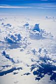Aerial, Aerials, Aircraft, Airplane, Altitude, Atlantic, Aviation, Blue, Calm, Cloud formation, Cloud formations, Clouds, Color, Colour, Concept, Concepts, Conceptual, Cumulus, Earth, Flight, Flying, Globe, Holidays, In flight, Jet, Motor, Plane, Reflect