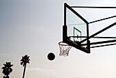 Achievement, Aim, Aiming, Ball, Balls, Basket, Basketball, Baskets, Color, Colour, Concept, Concepts, Daytime, Detail, Details, Exterior, Horizontal, Leisure, Outdoor, Outdoors, Outside, Recreation, Silhouette, Silhouettes, Sport, Sports, Success, K51-29