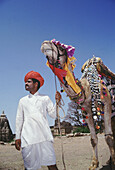 A typical Rajasthani man with his camel. The Rajasthanis not only adorn themselves but also their animals with jewellery. Rajasthan, India