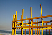Beach, Beaches, Blue, Blue sky, Coast, Coastal, Color, Colour, Concept, Concepts, Daytime, Detail, Details, Exterior, Fence, Fences, Horizontal, Obstacle, Obstacles, Outdoor, Outdoors, Outside, Pole, Poles, Rail, Railing, Railings, Rails, Sea, Skies, Sky