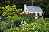 Grandma s Cottage in the flowers gardens of the English Gardens in Winnipeg, Manitoba Canada.