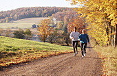 Jogging on country road in autumn