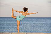 Exercise, yoga, caucasian-hispanic, age 30 to 40.