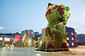 Guggenheim Museum by Frank O. Gehry with Puppy , sculpture by Jeff Koons, at fore. Bilbao. Biscay, Spain
