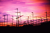 Antenna, Antennae, Antennas, Cities, City, Color, Colour, Communicate, Communication, Communications, Confused, Confusion, Dusk, Exterior, Horizontal, Industrial, Industry, Loneliness, Many, Obscurity, Outdoor, Outdoors, Outside, Pile, Piled-up, Purple,