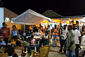 People visiting Friday Market at night, Oistins, Barbados, Caribbean