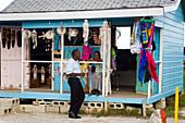 Two people at a souvenir shop at North Point, Barbados, Caribbean