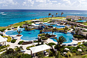 View over swimming pool area of the Crane Hotel, Atlantic Ocean in background, Barbados, Caribbean