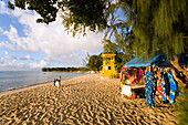 Souvenir stall and watch tower at beach, Speightstown, Barbados, Caribbean