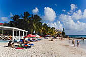 People relaxing at Accra Beach, Rockley, Barbados, Caribbean