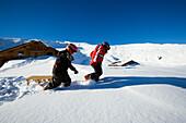 Children with a sledge near alpine hut, Maennlichen, Grindelwald, Bernese Oberland, Canton of Bern, Switzerland