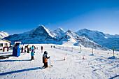 Children skiing near an alpine lodge, Maennlichen, Grindelwald, Bernese Oberland, Canton of Bern, Switzerland