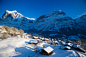 View over Grindelwald with mountain Wetterhorn and Schreckhorn in background, Grindelwald, Bernese Oberland, Canton of Bern, Switzerland