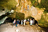Group of tourists visiting a cave, peninsula Shimoni, Coast, Kenya