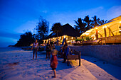 Guests attending a beach party in a beach restaurant, The Sands, at Nomad, Diani Beach, Kenya