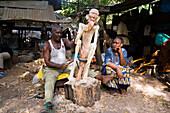 Man carving a figure, Akamba Village, Mombasa, Kenya