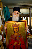 Icon painter Father Kallinikos holding a painting, icon, Stravrovouni monastery, Larnaka, South Cyprus, Cyprus