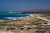 Coastal landscape with bus, coach, Cape Drepano, Akamas Natural Reserve Park, South Cyprus, Cyprus