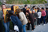 People holding icons at a procession, People kissing icons, Orthodox icon procession, Agros, Troodos mountains, South Cyprus, Cyprus
