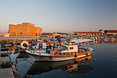 Paphos Castle with fishing boats, Reflection in the water, Paphos harbour, Paphos, South Cyprus, Cyprus