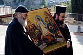 Two orthodox priests holding an icon, procession around church, Agros, Pitsilia region, Troodos mountains, South Cyprus, Cyprus