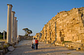 Tourists visiting the Antique Gymnasium, Palaestra, with columned courtyard, Archaeology, Salamis ruins, Salamis, North Cyprus, Cyprus