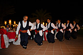 A small group of local men dancing in traditional costume, Folklore, Folk dance, Salamis Bay Conti Resort Hotel, Salamis, North Cyprus, Cyprus