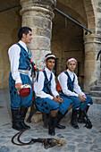 Three folk dancers in traditional costume, Buyuk Han, The Great Inn, Ottoman caravansary, Lefkosia, Nicosia, North Cyprus, Cyprus