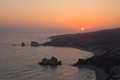 Petra tou Romiou at sunset, Rock of Aphrodite, Aphrodite's birthplace, Symbol, the Rock from which Aphrodite mythically arose from the sea, Limassol, South Cyprus, Cyprus