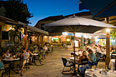 People sitting outside a restaurant, cafe in the evening, village square, Polis, South Cyprus, Cyprus