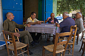 Local men playing cards outside a cafe, Kafenion, Kato Pyrgos, South Cyprus, Cyprus