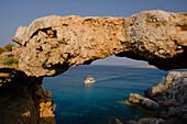 Rocky coastal landscape with natural bridge, Cape Gkreko, near Protaras, near Agia Napa, South Cyprus, Cyprus