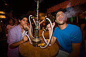 Two young men smoking a water pipe, nightlife, Club, Bar, Agia Napa, Cyprus