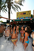 A group of young giels dancing at a foam party, beach party, Nissi Beach, Agia Napa, South Cyprus, Cyprus