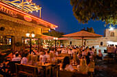 Young men and women sitting in a restaurant, bar, Nightlife in Agia Napa, South Cyprus, Cyprus