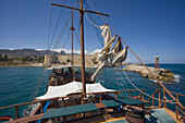 Neptun Pirate boat trip, by Kaleidoskop Turizm, and coast, castle in the background, Kyrenia, Girne, Cyprus