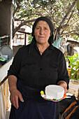 Local woman holding cheese, Eulambia Eracleous, halloumi cheese production, Kalavasos, Limassol area, Cyprus