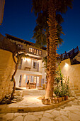 A person sitting on the patio relaxing, Traditional guest house with palm tree, Cyprus Villages Traditional Houses Ltd, agrotourism, Kalavasos, near Limassol, Cyprus