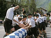 Men raising a maytree, Aschau, Bavaria, Germany